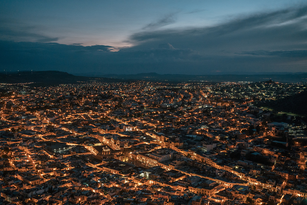 """View of Zacatecas from a hill. Shortly before López Obrador took office in December 2018, the CIA concluded that drug groups controlled about 20 percent of Mexican territory. The Mexican government denies it has lost control of any part of the country. But in a little-noticed passage in its security plan last year, it likened crime groups to insurgents, with """"a level of organization, firepower and territorial control comparable to what armed political groups have had in other places."""""""