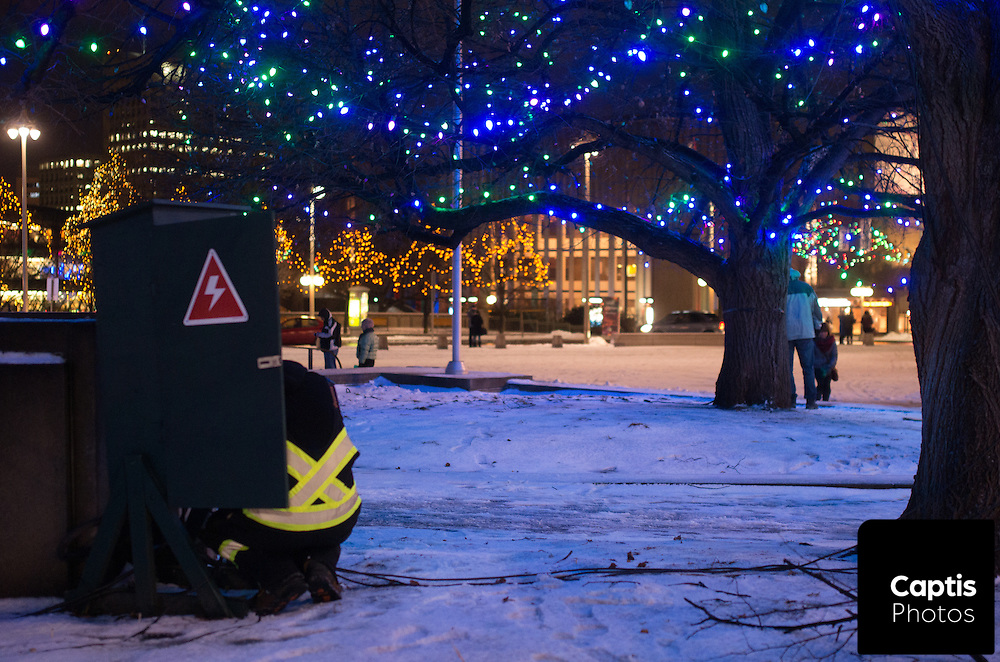 A man works on the power supply for Christmas lights near the National War Memorial. December 3rd, 2014.