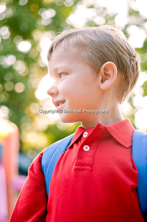 A boy gets ready for the first day of school