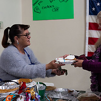 Ida Bickerton from the Lady's of Charity sells sweet potato pies helping raise funds for the jain and prison ministry during the Recycled Crafts Fair on November 2, 2019 in Gallup.