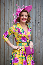 LIVERPOOL, ENGLAND - Friday, April 4, 2014: Norma Murphy of Runcorn wearing a Pin-up Girl dress and hat from John Lewis, who won the best dressed competition, during Ladies' Day on Day Two of the Aintree Grand National Festival at Aintree Racecourse. (Pic by David Rawcliffe/Propaganda)