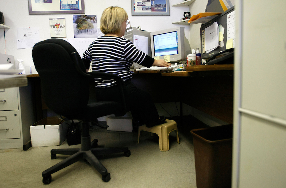 Barb Kotzian works at her desk in her job as a graphic designer at Alpine Printing in Arvada, Colorado March 22, 2010.  About four-feet-tall,  Barb and her husband are both achondroplasia dwarfs, a rare genetic disorder of bone growth.  Preferring to be called little persons they both are active in the Little People of America, the only dwarfism support organization that includes all 200+ forms of dwarfism.  REUTERS/Rick Wilking (UNITED STATES)