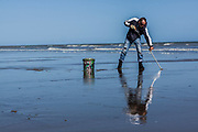 June 3, 2015 - Hastings, England, UK - A British man searching in invertebrates trace on the seashore of Hastings, a town in the southeast of England. (Credit Image: © Vedat Xhymshiti/ZUMA Wire)