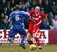 Photo: Chris Ratcliffe.<br />Gillingham v Bristol City. Coca Cola League 1. 26/12/2005.<br />Steven Brooker (R) of Bristol City takes on Ian Cox of Gillingham.