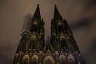 curfew from 9 pm during corona pandemic lockdown on May 5th. 2021. The cathedral is not illuminated during these nights, Cologne, Germany.<br /> <br /> Ausgangssperre ab 21 Uhr waehrend des Corona Lockdowns am 5. Mai 2021. Der Dom wird in diesen Naechten nicht angestrahlt, Koeln, Deutschland.