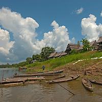 Thunderheads build over San Juan de Yanayacu village and the Yanayacu River in Peru's Amazon Jungle.