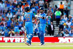 Virat Kohli (capt.) of India celebrates his 50, fifty, half century with Shikhar Dhawan of India (L)