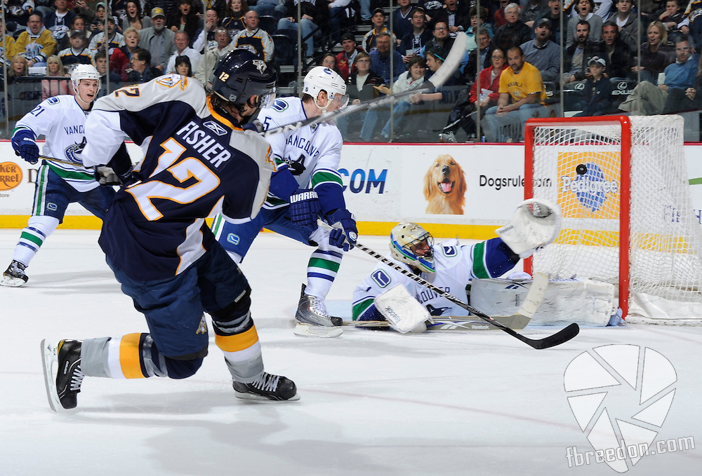 NASHVILLE, TN - MARCH 29:  Mike Fisher #12 of the Nashville Predators scores a goal on Roberto Luongo #1 of the Vancouver Canucks on March 29, 2011 at the Bridgestone Arena in Nashville, Tennessee.  (Photo by Frederick Breedon/Getty Images) *** Local Caption *** Mike Fisher;Roberto Luongo
