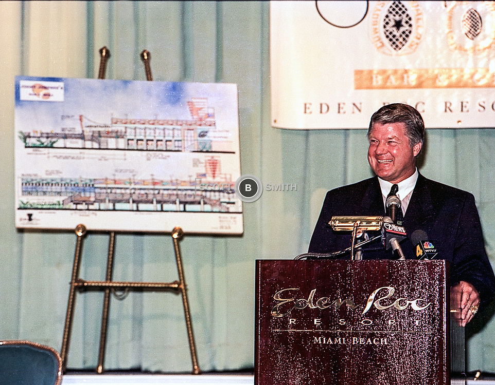 Coach Jimmy Johnson announcing and presenting his Three Rings Bar and Grill in the Eden Roc Resort Miami Beach October 1994