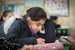 19 February 2020, Amman, Jordan: A girl attends class at the Al Yarmouk Primary Mixed School, in the Lewa'a Al Jama'a district. The school teaches some 750 students from 1st - 6th grade, most of them Jordanian, but some also from Syria and other countries. The school has received support from the Lutheran World Federation in refurbishing their buildings and classrooms, as well as training on protection and social cohesion, including how to become more inclusive of children with disabilities.