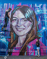 Edinburgh Science Festival, Edinburgh, Scotland, United Kingdom: <br /> Pictured: Watched by Valentina Maia, aged 6 years, graffiti and mural artist Shona Hardie puts the finishing touches to her portrait of Natalie Duffield, one of the artworks in a street art trail called 'Women in STEM' which showcases the achievements of nine women who have contributed to the world of Science, Technology, Engineering and Maths (STEM). Natalie Duffield is CEO of InTechnology SmartCitie, a company that provides free WiFi in central Edinburgh. Shona has also painted many of the other portraits in the trail which are displayed in venues across the city. <br /> The 2021 Edinburgh Science Festival runs from 26 June – 11 July.<br /> Sally Anderson | EdinburghElitemedia.co.uk