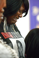 Nichole Mitchell sheds tears during a sermon of a youth service at the St. Paul Missionary Baptist Church in Sanford, Fla., Sunday, July 14, 2013.  Many in the congregation wore shirts in support of Trayvon Martin following the not guilty verdict given to George Zimmerman, who had been charged in the 2012 shooting death of Trayvon Martin.(AP Photo/Phelan M. Ebenhack)