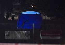 © Licensed to London News Pictures 18/09/2021. <br /> Kidbrooke, UK, A blue police forensic tent. A large police cordon is in place in Kidbrooke, South East London tonight after the body of a woman was found near a community centre. A man from Lewisham has been arrested on suspicion of murder. Photo credit:Grant Falvey/LNP