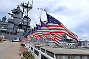 Approach to the USS Missouri, lined with USA flags. Battleship Missouri Memorial, Pearl Harbour, Hawaii