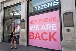 © Licensed to London News Pictures. 14/06/2020. London, UK. A woman walks past the Regent Street branch of Tezenis. The government has announced that all non-essential retailers can re-open on Monday 15 June as the coronavirus lockdown restrictions are eased . Photo credit: George Cracknell Wright/LNP