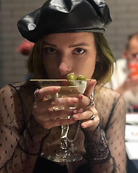 "Bella Thorne releases a photo on Instagram with the following caption: ""I had wayyyy 2 many dirty martinis last night happy new year \u2764\ufe0f"". Photo Credit: Instagram *** No USA Distribution *** For Editorial Use Only *** Not to be Published in Books or Photo Books ***  Please note: Fees charged by the agency are for the agency's services only, and do not, nor are they intended to, convey to the user any ownership of Copyright or License in the material. The agency does not claim any ownership including but not limited to Copyright or License in the attached material. By publishing this material you expressly agree to indemnify and to hold the agency and its directors, shareholders and employees harmless from any loss, claims, damages, demands, expenses (including legal fees), or any causes of action or allegation against the agency arising out of or connected in any way with publication of the material."