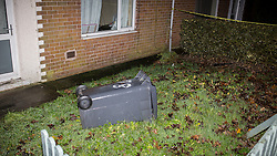 © Licensed to London News Pictures . 08/12/2013 . 78 Springwood Hall Road , Oldham , UK . An upturned wheelie bin in the house's front garden . The 22 year old mother of a four-month old girl , Victoria Adams , was found stabbed in the chest at 78 Springwood Hall Road , Oldham , yesteday morning (8th December 2013) . She later died in hospital . A 29 year old man has been arrested on suspicion of murder .  . Photo credit : Joel Goodman/LNP