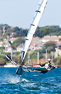 Paul Goodison, former Laser Olympic and World champion, sailing his Foiling Moth in Portland Harbour.<br /> Picture date: Sunday September 21, 2014.<br /> Photograph by Christopher Ison ©<br /> 07544044177<br /> chris@christopherison.com<br /> www.christopherison.com