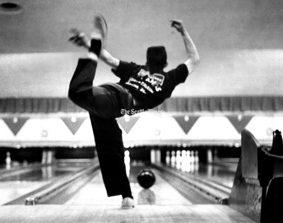 Ron De Rosa, Times staff photographer won the $500 first prize in the Brunswick Corporation's 1963 National Bowling Photo Contest. The candid photographs captured the drama of a night of bowling in March, 1962, at Ideal Recreation. De Rosa used a T-model Rolleiflex and tri-X film. With available light only, he shot at 1/60 of a second with lens opening of f 3.5. (Ron De Rosa / The Seattle Times)