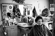 Hair stylist Melissa Kohenskey (right) works on Janice Curly's hair at Kohenskey's beauty shop, MK Styles, in Edgar Springs, Missouri.