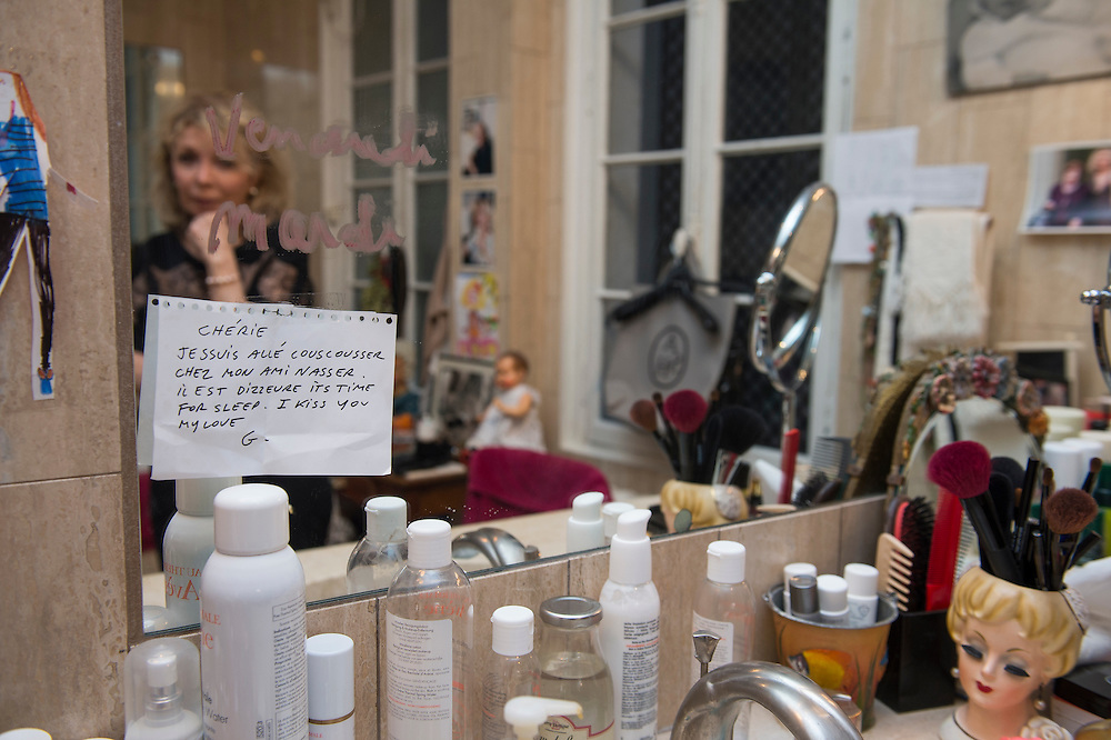 """March 6, 2015, Paris, France. Post-it notes decorate the Paris' apartment where Georges and Maryse Wolinski used to live. French Cartoonist Georges Wolinski (1934 –2015) wrote daily post-it notes to his wife Maryse Wolinski (1943, Algiers). Two month after the death of Georges Wolinski, the apartment is full of souvenirs and notes, attesting a half-century-long love relation: """"Darling, I went eating couscous with my vriend Nasser, it' s ten oclock, it's time for sleep, I kiss you my love. G."""" <br /> The cartoonist Georges Wolinski was 80 years old when he was murdered by the French jihadists Chérif en Saïd Kouachi, he was one of the 12 victims of the massacre in the Charlie Hebdo offices on January 7, 2015 in Paris. Charlie Hebdo published caricatures of Mohammed, considered blasphemous by some Muslims. During his life, Georges Wolinski defended freedom, secularism and humour and was one of the major political cartoonists in France. The couple was married and had lived for 47 years together. Photo: Steven Wassenaar."""
