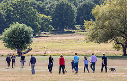 """© Licensed to London News Pictures. 12/09/2020. Surrey, UK. Families enjoy a glorious walk in the sunshine in Richmond Park in South West London this afternoon before the """"Rule of 6"""" comes into force on Monday as weather experts announce a 6 day mini heatwave in the South East of England this week with highs in excess of 29c. Prime Minister Boris Johnson is already under pressure after he announced on Friday that gatherings of more than six people will be banned from Monday in the hope of reducing the coronavirus R number. The Rule of Six as it is known, has already become unpopular with MPs and large families. Photo credit: Alex Lentati/LNP"""