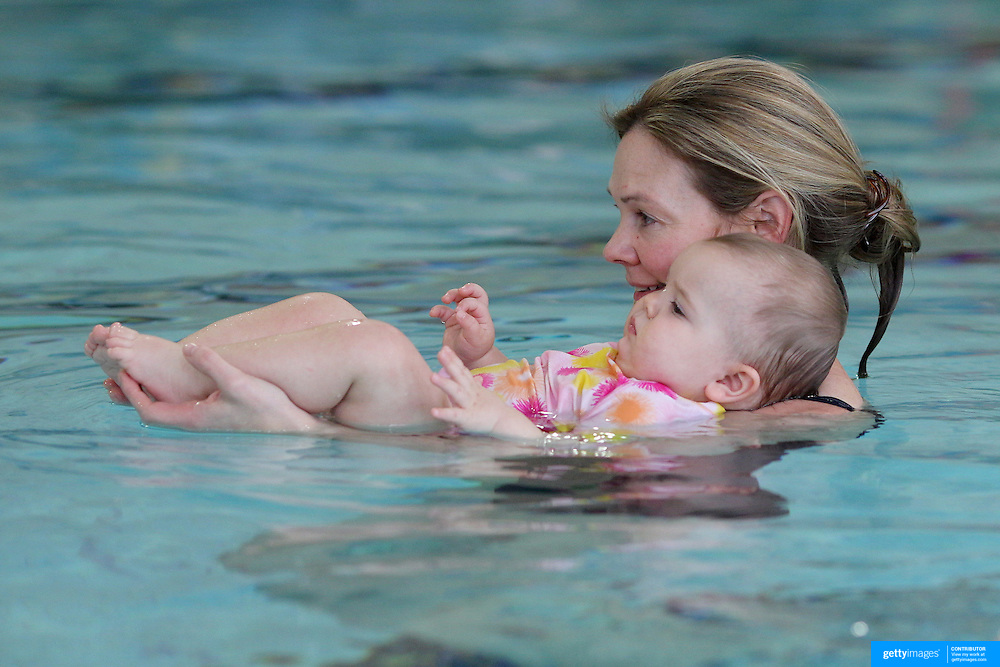 A nine month old baby girl and her mother at a learn to swim class. Photo Tim Clayton