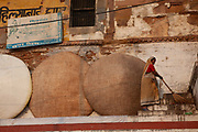 A woman on the banks of the river ganges at dawn on 21st December 2009, Varanasi / Benares, Uttar Pradesh, India. According to Hindu mythology, Varanasi was founded by Shiva, one of three principal deities along with Brahma and Vishnu, and is seen as a significant and holy place to followers of the Hundu faith.