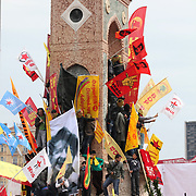 Demonstrators gather around a monument during a May Day rally at Taksim square in central Istanbul May 1, 2011. More than 250,000 Turkish workers thronged a central Istanbul square on Saturday for May Day celebrations, held there for the first time since the late 1970s, when unknown gunmen massacred dozens of people. Photo by TURKPIX
