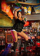 Bartender Monica Fortich serves Markos Alarcon at the Coyote Bar in Holywood.