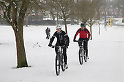 Snow cyclingfun in Highbury Park as freezing weather, dubbed The Beast from the East due to the sub zero cold temperature winds coming in from Siberia, descends on Kings Heath on 3rd March 2018 in Birmingham, United Kingdom.