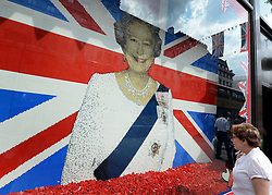 © Licensed to London News Pictures. 30/05/2012. London, UK People walk past a window display of HRHQueen Elizabeth are of LEGO bricks in the Hamely's toy shop window. Preparations today 20th May 2012 around London ahead of The Queen's Diamond Jubilee this weekend. Photo credit : Stephen Simpson/LNP