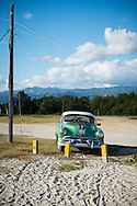 A vintage Pontiac from the 1950s is parked at Playa Ancon, a beach destination several kilometers from Trinidad, Cuba.