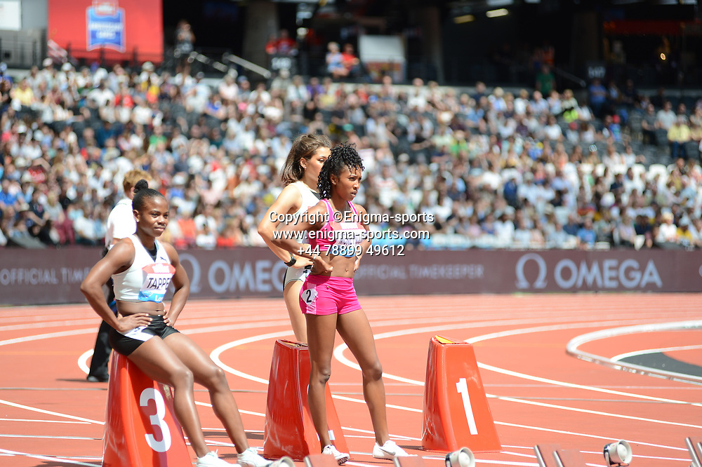 Tiffani McReynolds competes in the women's 100m hurdles during the IAAF Diamond League at the Queen Elizabeth Olympic Park London, England on 20 July 2019.