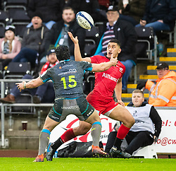 Manu Vunipola of Saracens under pressure from Dan Evans of Ospreys<br /> <br /> Photographer Simon King/Replay Images<br /> <br /> European Rugby Champions Cup Round 5 - Ospreys v Saracens - Saturday 11th January 2020 - Liberty Stadium - Swansea<br /> <br /> World Copyright © Replay Images . All rights reserved. info@replayimages.co.uk - http://replayimages.co.uk