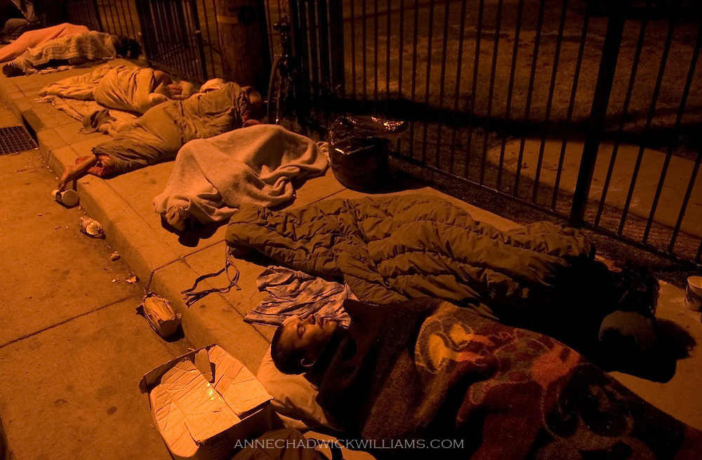 Chris Bockover, 18, foreground, who has been homeless for five days, sleeps with other homeless in front of the Union Gospel Mission in Sacramento, CA on August 10, 2005. Police say that the Bannon Street mission has become a hotspot for the homeless to sleep outside on the sidewalk and nearby fields.