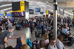 The main concourse  is crowded with passengers unable to board their flights at Terminal 5 at Heathrow Airport after an IT glitch brings British Airways systems to a halt, causing disruption to thousands of passengers with flights cancelled and delayed. London, August 07 2019.