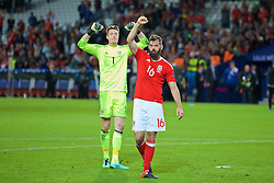 LILLE, FRANCE - Friday, July 1, 2016: Wales goalkeeper Wayne Hennessey and Joe Ledley salute the supporters as they celebrate the 3-1 victory against Belgium at full time after the UEFA Euro 2016 Championship Quarter-Final match at the Stade Pierre Mauroy. (Pic by Paul Greenwood/Propaganda)