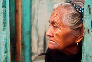 -- SAN CRISTOBAL DE LAS CASAS, CHIAPAS, MEXICO: A woman watches the street from the doorway of her home in San Cristobal de las Casas, Chiapas, Mexico. .©  JACK KURTZ   WOMEN  POVERTY  INDIGENOUS