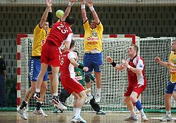 Rok Terzan shoting, and Zoran Jovicic defending at MIK First league Handball match between RK Cimos Koper and RD Slovan, on May 9, 2009, in SRC Bonifika, Koper, Slovenia.  (Photo by Vid Ponikvar / Sportida)