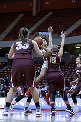 01 November 2017: Ajai Simmons takes a shot over Ashley Harfst during a Exhibition College Women's Basketball game between Illinois State University Redbirds the Red Devils of Eureka College at Redbird Arena in Normal Illinois.