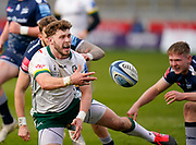 London Irish Centre Theo Brophy-Clews off loads as he breaks through the Sale Sharks defence during a Gallagher Premiership Round 14 Rugby Union match, Sunday, Mar 21, 2021, in Eccles, United Kingdom. (Steve Flynn/Image of Sport)