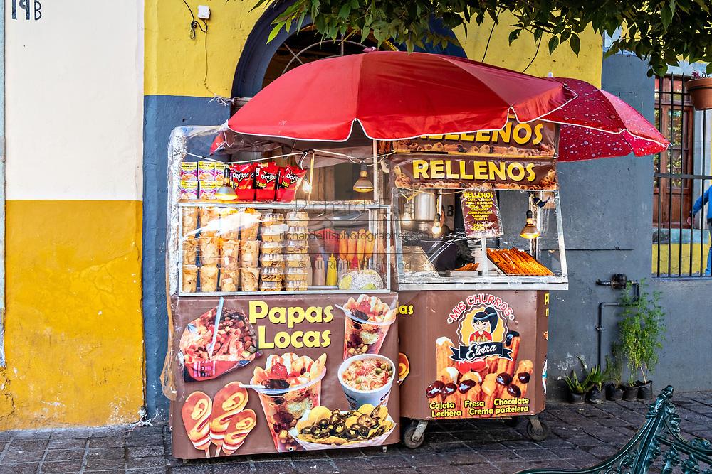A street food vendor in the historic center of Guanajuato City, Guanajuato, Mexico.