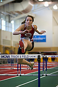 Central College Pentathlete Caitlin Wilson leaps during the Women's 60m hurdle competition on Friday of the NCAA Division III Indoor Track and Field National Championships.