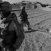 Sep 07, 2009 - Farah Province, Afghanistan -  US Marines prepare to continue a patrol after questioning an Afghan boy about insurgents in a village during a clearing operation in Golestan just before entering the dreaded Buji Bast Pass (aka Bhuji Bast) in Farah Province, Afghanistan.<br /> (Credit Image: © Louie Palu/ZUMA Press)