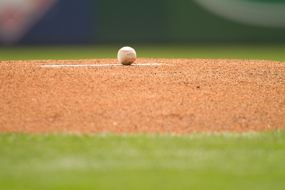 Detail shot of baseball on pitcher's mound pre-game. Seattle Mariners at Texas Rangers. Phootgraphed at Rangers Ballpark In Arlington in Arlington, Teas on Saturday, April 10, 2010. Photograph © 2010 Darren Carroll.