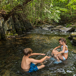 Siblings swims at Red River Falls in Aroostook County, Maine. Deboullie Public Reserve Land.