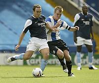 Photo Aidan Ellis.<br /> Sheffield Wednesday v Manchester City.<br /> Friendly match at Hillsbrough.<br /> 31/07/2005.<br /> City's L Croft battles with Wednesday's Glen Whelan