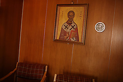 A painting of Saint Nicholas watches over the crew onboard the Alfa K, a Mediterranean based bulk carrier with a Panamanian flag, which was undergoing repairs at the port of Piraeus in Greece on Feb. 20, 2008. Inspectors impose ITF-standard treaties on ship-owners to guarantee minimal standard working conditions for seafarers. They are on call 24 hours a day to address concerns from workers coming to port on the international ships.