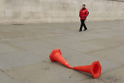 Two traffic cones set up as a skateboard jump in Trafalgar Square on 25th May 2021 in London, United Kingdom.